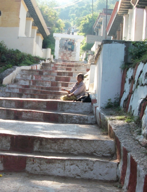 Woman Begging on Steps of Chimundi Hill